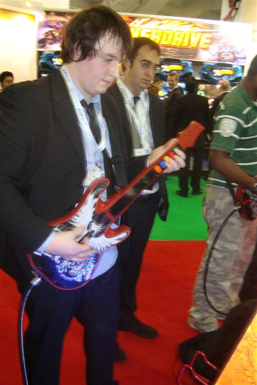 Adam playing Guitar Hero Arcade